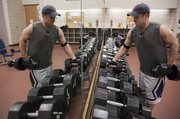 Jon Rupp, law school student from Wichita, uses the free weights at Ambler Student Recreation  Fitness Center.
