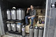Will Savitri, owner of Katalyst Kombucha fermented tea, drinks some tea from inside his refrigerated storage unit in this July 1 photo at the Katalyst Kombucha company in Greenfield, Mass. Regulators are concerned that the tea may need to be regulated as an alcoholic drink. Some bottles have more than 0.5 percent alcohol, the legal limit for a drink not to be considered alcoholic.