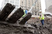 Planks from a 32-foot-long 18th century ship stick out of the mud Thursday at the World Trade Center site in New York.