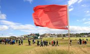 A flag flaps in the wind on the Old Course at St. Andrews, Scotland, as play was suspended due to strong wind Friday in the second round of the British Open.