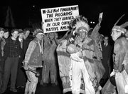 Iroquois Indians who were born in Canada march Dec. 26, 1940, through the main street of Buffalo, N.Y., carrying signs protesting that the U.S. pilgrim fathers were not required to be fingerprinted. They registered as aliens. An American Indian lacrosse team's refusal to travel on passports not issued by the Iroquois confederacy goes to the heart of one of the most sensitive issues in Indian Country: sovereignty.