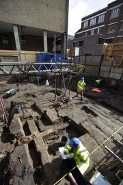 "Archaeologists work Thursday on an  excavation site of London's first theater, where William Shakespeare's plays were first performed. In Elizabethan times the theater lay outside the city walls — free from regulation by city leaders hostile to theaters and other ""disreputable"" entertainments. The remains of the original theater will be displayed under glass at the new site."