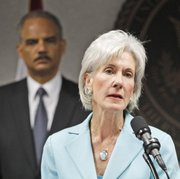 Health and Human Services Secretary Kathleen Sebelius talks to reporters during a news conference as Attorney General Eric Holder looks on Friday in Miami. Federal authorities said they are conducting the largest Medicare fraud bust ever in five different states and arrested dozens of suspects accused in scams totaling $251 million.