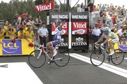 Joaquin Rodriguez Oliver of Spain crosses the finish line to win the 12th stage of the Tour de France over 210.5 kilometers (130.8 miles). Rodriguez finished ahead of runner-up Alberto Contador of Spain, right, on Friday in Mende, France.