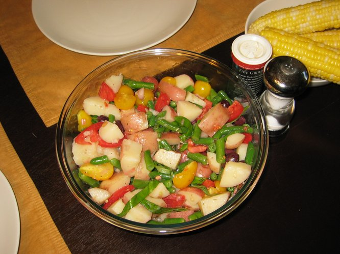 Our garden potatoes and tomatoes mixed nicely with olives, green beans and CSA basil.