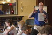 Pre-med adviser Paul Crosby, right, explains some of the ins and outs of surviving the first year of college.
