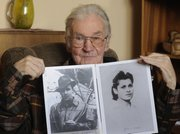 Jerzy Bielecki presents photos of him in 1944, left, and Cyla Cybulska in 1945, in his home in Nowy Targ, southern Poland, in this May 11 photo. Sixty-six years ago, Bielecki, then an Auschwitz Birkenau prisoner, escaped from the death camp with his Jewish girlfriend, Cybulska.