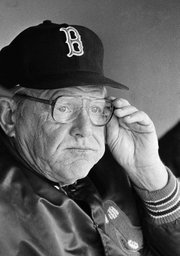 Ralph Houk, then manager of the Boston Red Sox, waits out a rain delay in this file photo from June 13, 1982. Houk died Wednesday at 90.