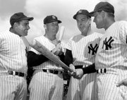 Then-Yankees manager Ralph Houk, right, visits with, from left, Yogi Berra, Mickey Mantle and Joe DiMaggio in this file photo from March 9, 1961. Houk, a Lawrence native who managed the Yankees of the early 1960s, died Wednesday.
