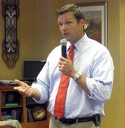 Kris Kobach, a Republican running for Kansas secretary of state, answers questions during a forum in this July 22 photo at the Tallgrass Creek retirement center in Overland Park, Kan. Kobach says President Barack Obama could resolve questions surrounding his citizenship by releasing a detailed birth certificate.