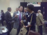 KU Chancellor Bernadette Gray-Little talks with K-State President Kirk Schulz at the Kansas Bioscience Authority's meeting in Overland Park on Monday.