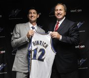 Kansas University product Kirk Hinrich, left, poses for a photo with Washington Wizards president Ernie Grunfeld during a media availability session Monday in Washington.