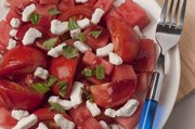 Watermelon salad with tomatoes, goat cheese and basil.