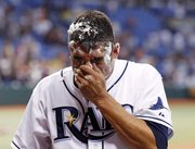 Tampa Bay Rays pitcher Matt Garza wipes away the remains of a pie during a television interview after his no-hitter against the Tigers Monday in St. Petersburg, Fla. It was the fifth no-hitter of the season.