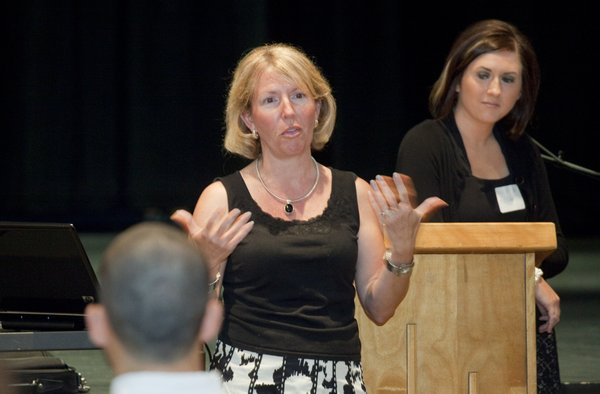 Linda Koester-Vogelsang,  left, court adminstrator at Douglas County District Court, and Paige Wilson, human resources manager at Golf Course Superintendents Association of America, share some of the health initiatives they have established at their workplaces. The two spoke July 28, 2010, at a workplace wellness workshop at South Junior High School.