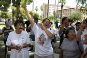 Opponents of Arizona State Bill 1070 celebrate Wednesday outside the Capitol in Phoenix.
