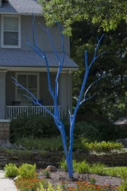 A blue tree sits in front of 1425 New York.