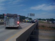 Emergency crews work to clear an accident on I-470 near Gage Boulevard in Topeka on Friday, July 30.