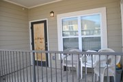 A boarded door of the lower-level apartment was evidence of Sunday morning's shooting incident at The Exchange. Local law enforcement reported eight people were injured during the August 1 incident.