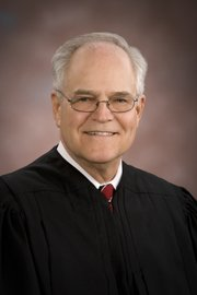 Kansas Supreme Court Chief Justice Robert E. Davis announced Tuesday morning that he would resign immediately because of health reasons.