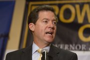 Republican gubernatorial candidate, Sen. Sam Brownback speaks to a crowd at the Overland Park Marriott for a watch party organized by the Johnson County Republican Party, Tuesday, Aug. 3, 2010.