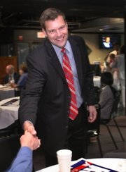 Kansas Secretary of State candidate Kris Kobach greets supporters at an election watch party Tuesday.