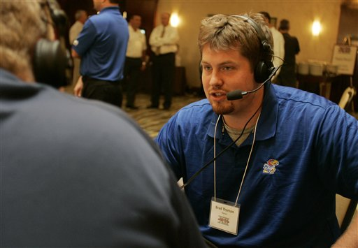 KU offensive lineman Brad Thorson talks during a radio interview at Big 12 media days in Irving, Texas.