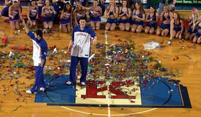 Kansas seniors Kirk Hinrich, left, and Nick Collison salute the crowd during a flower-showering ceremony before Saturday's game against Oklahoma State.