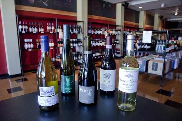 Specialty wines from all over the world fill the shelves at City Wine Market. About 90 percent of the stores inventory is priced under $25.