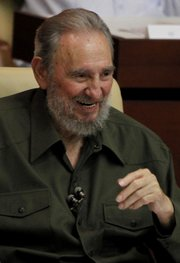 Fidel Castro speaks during a special session of parliament in his first official government appearance in front of lawmakers in four years Saturday in Havana, Cuba.