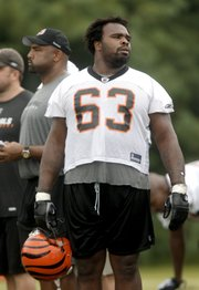 Cincinnati Bengals guard Bobbie Williams (63) looks on during football training camp July 29 in Georgetown, Ky. An analysis of league rosters shows the number of 300-pounders has risen dramatically over the decades.