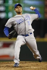 Kansas City pitcher Bruce Chen throws in the second inning against the Seattle Mariners on Saturday in Seattle.