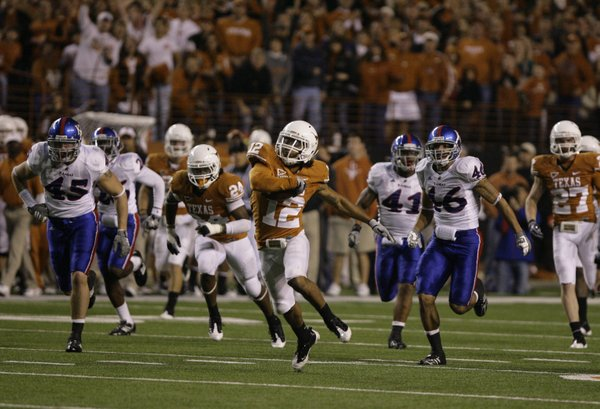 Texas kick returner Earl Thomas races up the field past the Kansas defense for a big return on Nov. 21, 2009, in Austin, Texas.