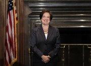 Elena Kagan smiles after becoming the Supreme Court's newest member Saturday at the Supreme Court Building in Washington. Kagan, 50, who replaces retired Justice John Paul Stevens, becomes the fourth woman to ever sit on the high court.