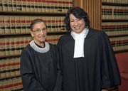 Justice Ruth Bader Ginsburg, left, and Justice Sonia Sotomayor pose for a photo in the Justices' Conference Room in this file photo released Sept. 8, 2009, by the Supreme Court of the United States.