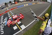 Juan Pablo Montoya takes the checkered flag. Montoya won the Sprint Cup race Sunday in Watkins Glen, N.Y.