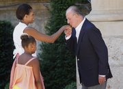 Spain's King Juan Carlos, right, welcomes U.S. first lady Michelle Obama and daughter Sasha, 9, on their arrival Sunday at the Marivent Palace in Palma de Mallorca, Spain.