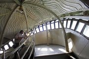 Statue of Liberty park ranger Lance Williams looks out the windows inside the crown of the statue in this May 20, 2009, photo in New York. Next year, the statue will close for nine months to a year so workers can build a more up-to-date set of stairwells at Lady Liberty's pedestal.