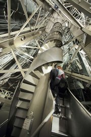 A journalist ascends the narrow spiral staircase to the crown inside the Statue of Liberty in New York in this May 20, 2009, photo.