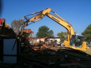Construction crews tear down McDonald's, 901 W. 23rd Street, on Tuesday, August 10, 2010. The building was constructed 40 years ago, and was the first McDonald's in Lawrence.