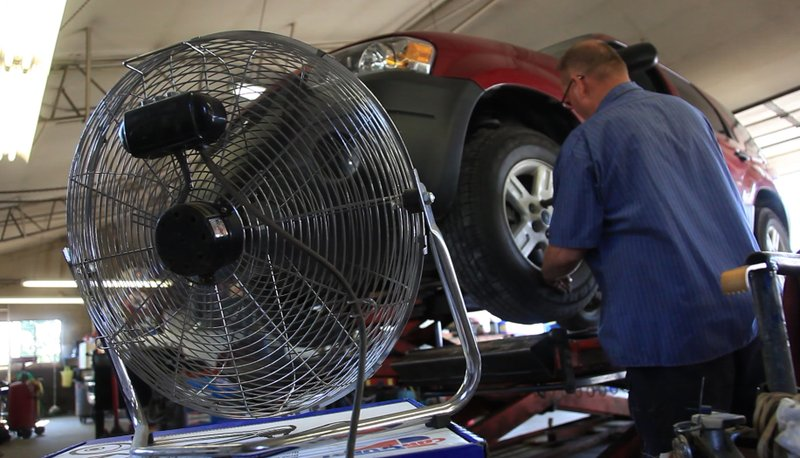 Last summer, a mechanic at Ace Steering and Brake Service tried to keep cool with a fan as temperatures hit triple digits. Those hot temperatures are expected to return this week, and health professionals are encouraging people to take precautionary measures such as drinking plenty of water and wearing loose-fitting clothing to avoid heat-related illnesses.