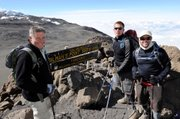 Amputee war veterans, from left, Kirk Bauer, 62, Ellicott City, Md.; Neil Duncan, 26, Denver; and Dan Nevins, 37, Jacksonville, Fla., pose together at Gilman's point before making the last push to the summit of Mt Kilimanjaro, Tanzania, in this Aug. 6 photo released by Disabled Sports USA. Bauer lost his leg in Vietnam; Duncan lost both legs in Afghanistan and Nevins lost both legs in Iraq.
