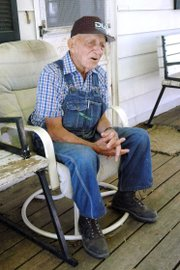 "Max Moore, 92, shown at his farm near Baldwin City, won the first tractor pull at the Vinland Fair in the early 1960s. ""They gave me an old flour sack with 50 silver dollars in it,"" he said. ""I&squot;ve still got them."""