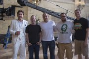 "Actor Timothy Hutton, left, KU intern Scott Root, producer/director Marc Roskin, KU interns Josh Nathan and am Findlay pose on the set of ""Leverage."""