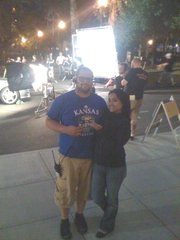 "Josh Nathan poses with extra Caylene Gonzalez on the Portland, Ore., set of ""Leverage."""