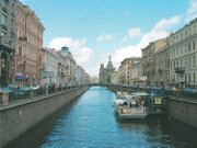 This canal shows a distant view of the Church of the Savior on Spilled Blood. The church was built on the location where Tsar Alexander II of Russia was assassinated.
