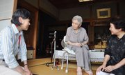 A Kobe city official, left, visits 100 year-old Mitsue Watase, center, Tuesday at Watase's home in Kobe, western Japan, as the officials started a door-to-door survey on the whereabouts of centenarians. Japan prides itself on having the world's longest life expectancy, but it is now struggling with  revelations that hundreds listed as its oldest citizens are either long dead or haven't been heard from for decades.