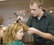 Jake Masters, Parkville, Mo., an apprentice cosmetologist at Z's Cosmetology Academy, prepares to do a coloring with client Katelyn Anderson, Lawrence. Masters will graduate from Z's in December.