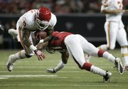 Kansas City Chiefs running back Tim Castille, left, is upended by Atlanta's Christopher Owens. The Falcons beat the Chiefs, 20-10, on Friday in Atlanta.