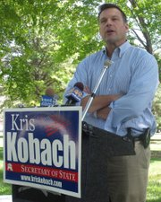 Kris Kobach, Republican candidate for Kansas secretary of state, discusses his voter initiative proposal July 27 outside the Statehouse in Topeka. The proposal would allow voters to put proposed laws and constitutional changes on the ballot without going through the Legislature.